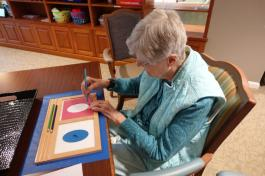 A resident participates in montessori activities
