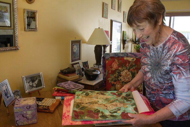 "Virginia ""Ginny"" Crandall looks through a few of her sheer fabric collages."