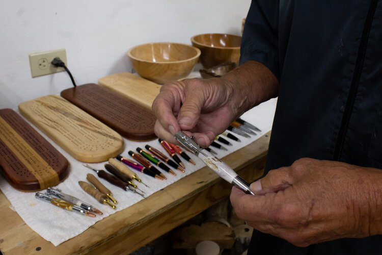Frank Tiahrt demonstrates how one of his hand-crafted pens works.