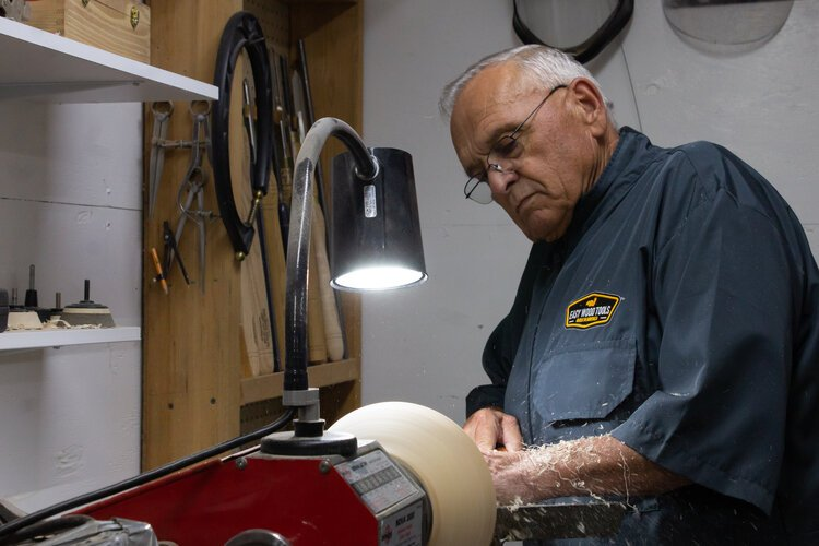 Frank Tiahrt demonstrates how he carves out the center of a bowl.