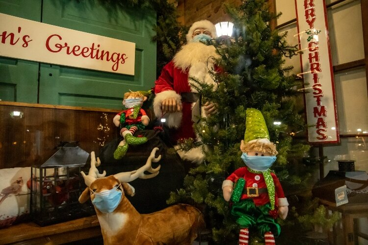 In the window of Little House, 924 N. Water St., Santa and his elves are donning masks to slow the spread of COVID-19 during the holidays.