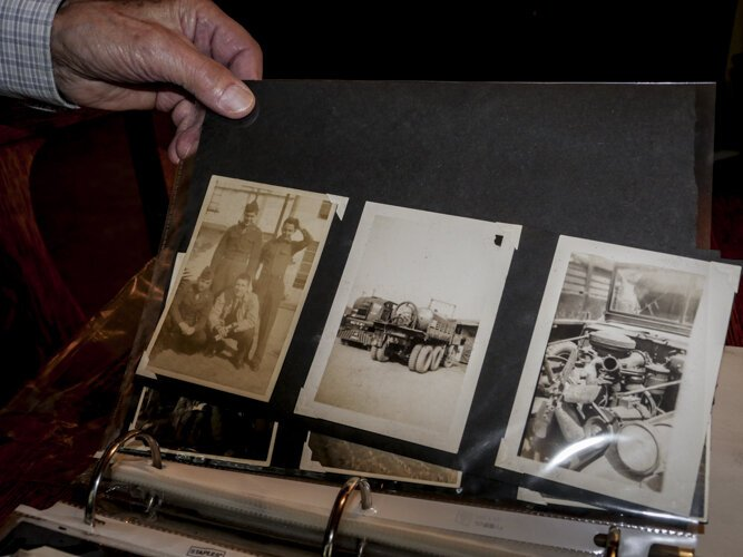 WWII veteran Ed Haynack shows photos from his time in the Army while he was in Japan.