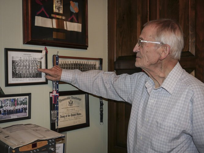 Ed Haynack points out himself in a photo from his military service.