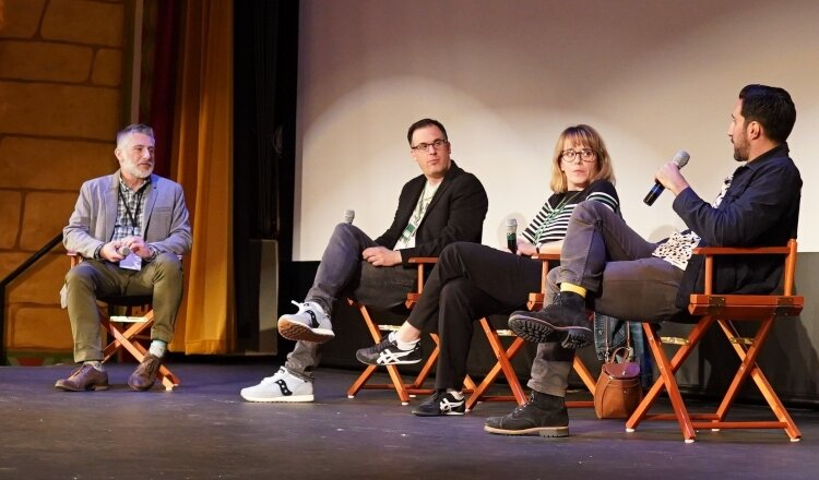 Festival Director Alan LaFave, at left, leads a panel discussion after a film during the 2019 festival.