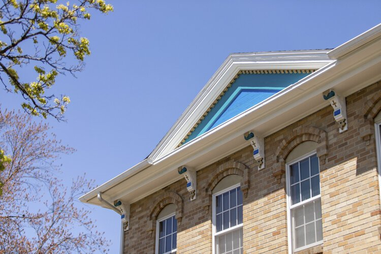 An overview of roofing at 503 East Broadway boasts blue and gold details.