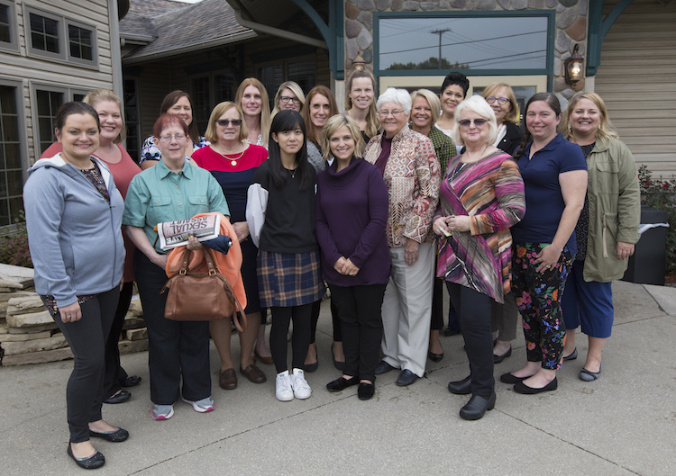 The women of the Mt. Pleasant Rotary Club pose for a photo outside Mountain Town Station following their meeting on Monday, Oct. 8, 2018.