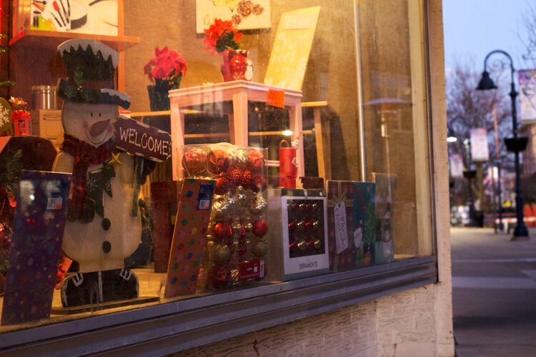 Christmas decorations are displayed in a window in downtown Mt. Pleasant.