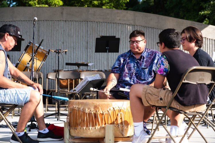 Onion Creek Drummers from the Saginaw Chippewa Indian Tribe perform at the Island Park Arts Pavilion's inaugural concert on Monday, Aug. 5.