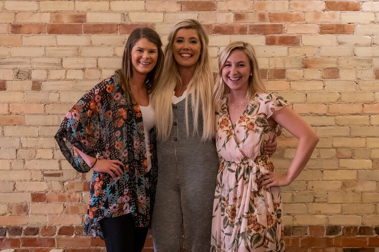 From left to right: Samantha Walters, Morgan Humphrey, and Kelsey Driessnack. Together, they manage the three businesses that make up the 500 District, owned by Morgan Humphrey.