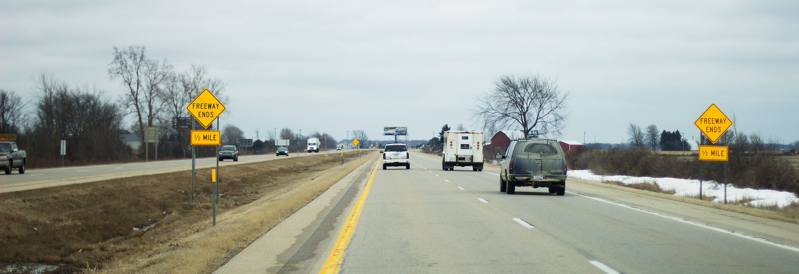 Signs warn motorists that the limited-access freeway ends in 1/2 mile on Southbound US-127 near Ithaca, MI