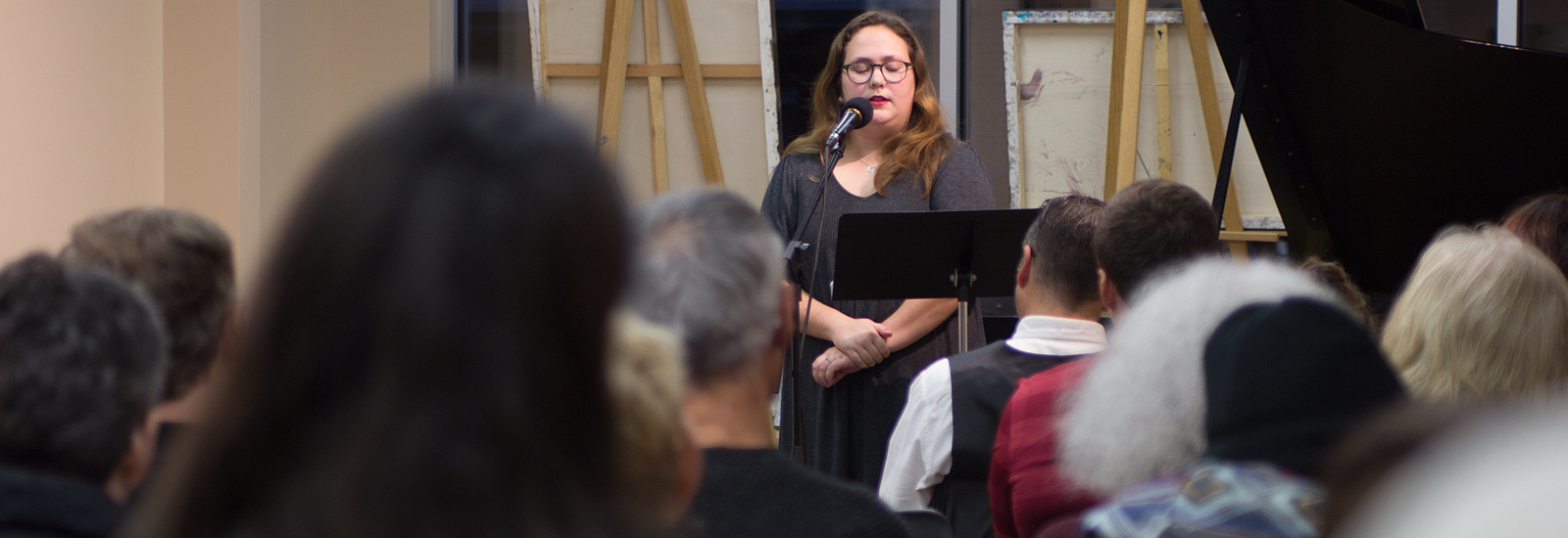 Liz O'Donnell joined professional poet Marc Hudson as the student reader at last month's event <span class='image-credits'>Diana Prichard</span>