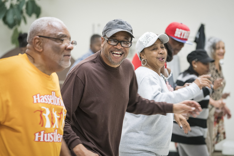 Gardell Haralson, 64 (center left) laughs as he dances with the Hasselbring Hustlers at the Hasselbring Senior Community Center. Haralson helped grow the Hustlers from a meager 15 participants to approximately 150 over the past four years.