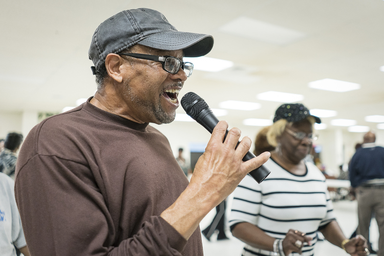 "Gardell Haralson, 64, from Flint, calls out steps as the Hustlers dance at the Hasselbring Senior Community Center. Haralson earns little money from the two classes he teaches each week, insisting the money go to the center for improvements. ""Some pe"