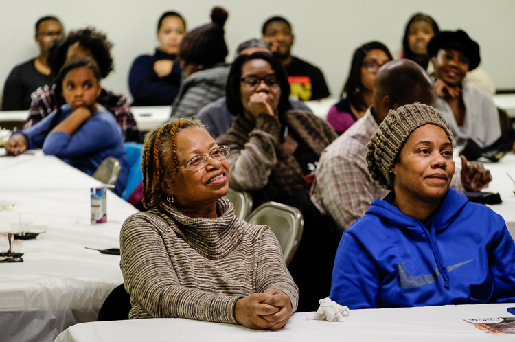 Gloria Brown of Burton (left) and daughter Mikasa Brown of Flint listen to presentations at the Flint SOUP event last week in January 2018 at the Church of the Harvest International  in Flint.