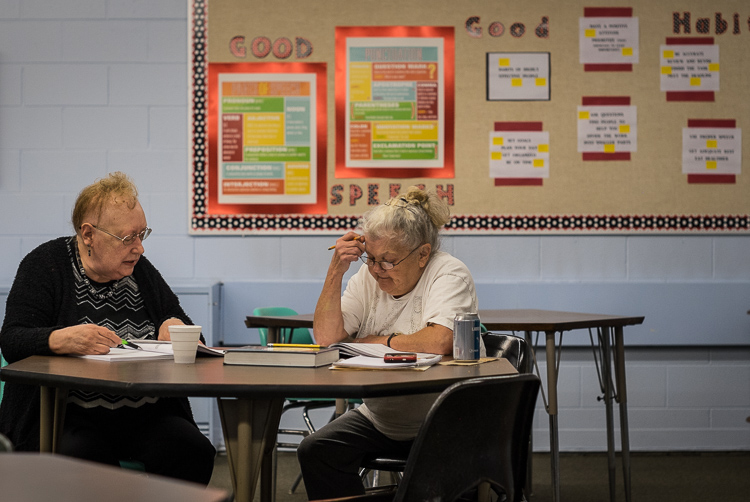 "Volunteer Carol Piechocki (left) of Grand Blanc Township tutors Linda Allen of Flint in the literacy center at St. Luke's. ""I love it here,"" says Allen."
