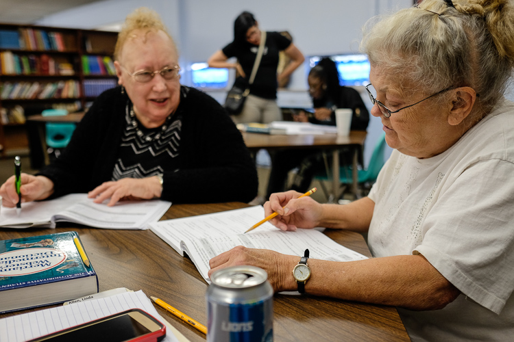 "Volunteer Carol Piechocki (left) of Grand Blanc Township tutors Linda Allen of Flint in the literacy center at St. Luke N.E.W. Life Center. ""I love it here,"" says Allen."