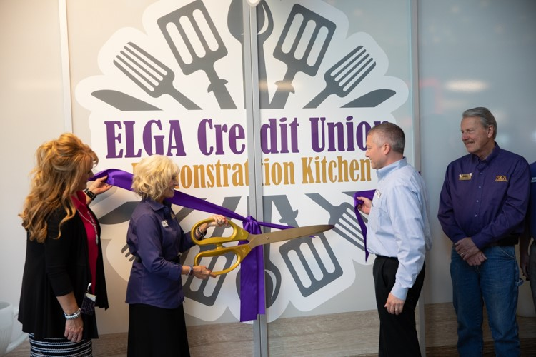 The ribbon cutting for the new ELGA Credit Union Demonstration Kitchen at the Flint Farmers' Market.