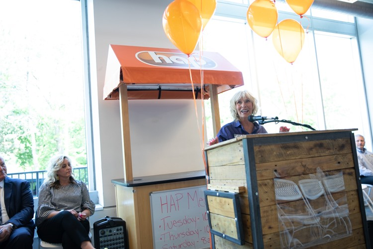 Karen Church, CEO of ELGA Credit Union, speaks at a press conference before the ribbon cutting for the Flint Farmers' Markets renovated demonstration kitchen.