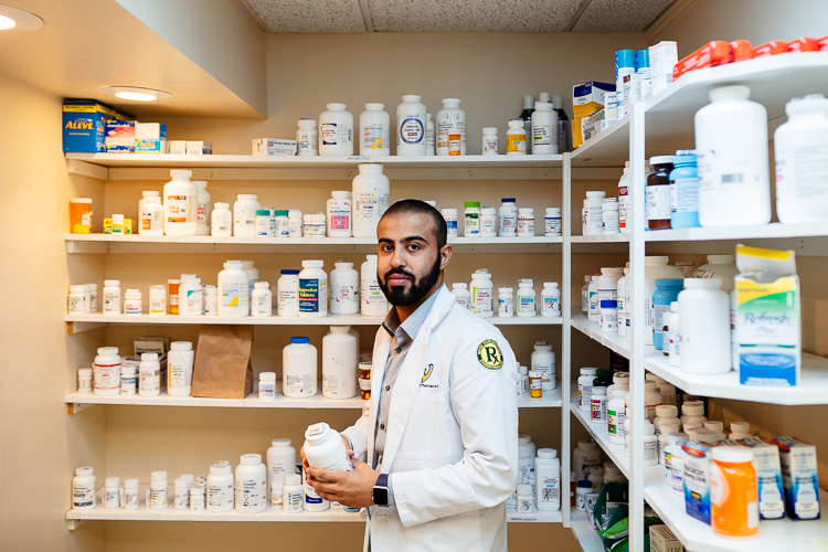 Wayne State University pharmacy student Abdullah Mattit volunteers at HUDA.