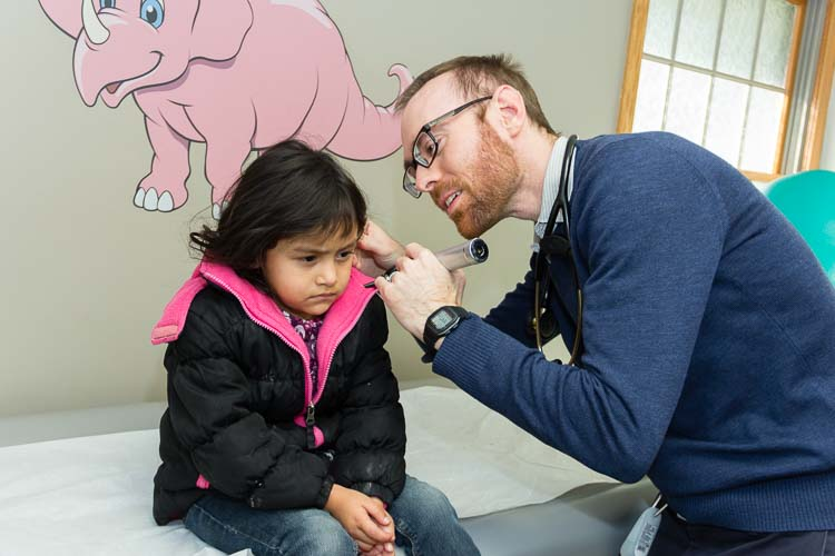 Daniel J. Ebenhoeh sees a young patient at Holy Family Healthcare.