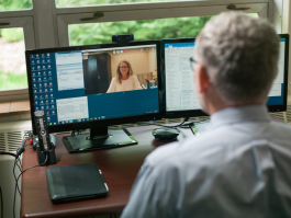 Bruce Retterath demonstrates use of a telepsychiatry system.