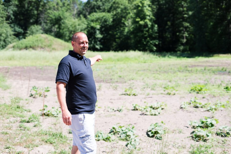 Lee Township-based community health worker Jerry Burton shows off a community garden he established for local residents.