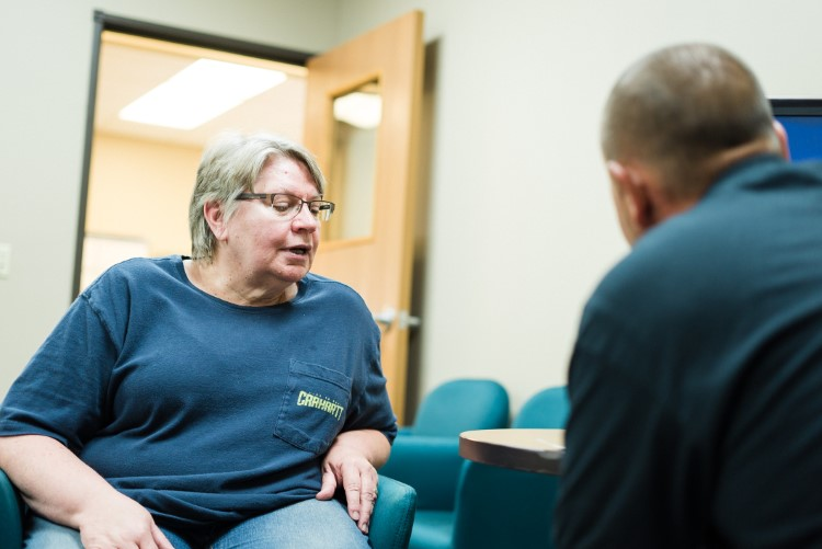 Lee Township resident Judy Wirtz confers with community health worker Jerry Burton.