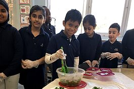 Students toss a healthy kale salad.