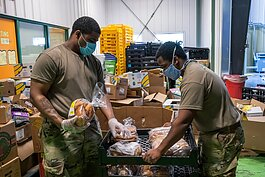 Michigan National Guard members volunteer at Food Gatherers.
