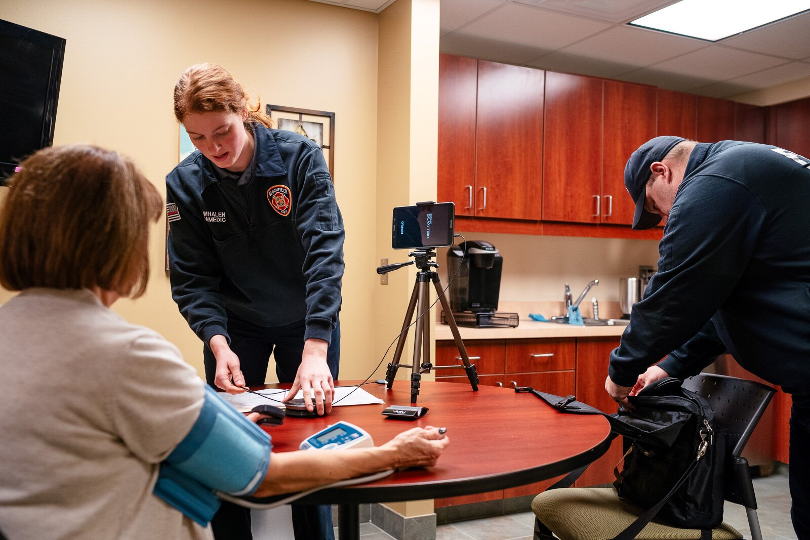 Community integrated paramedics Kim Whalen and Lt. Kevin Bailey of the Bloomfield Township Fire Department conduct a patient visit.