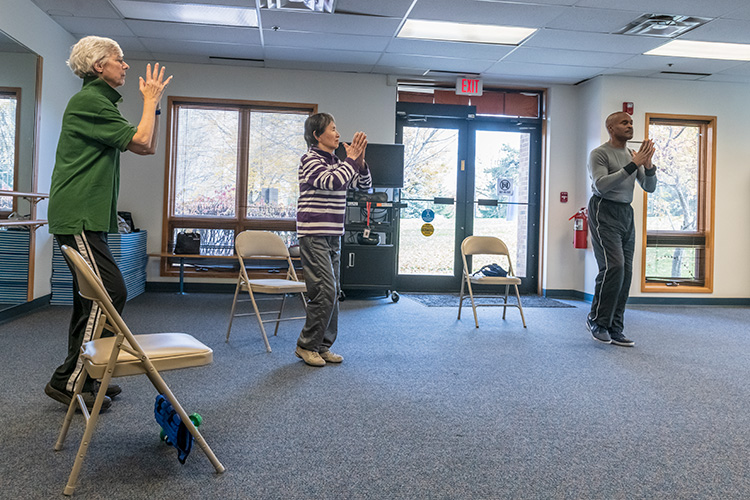 Paul Clark leads an enhanced fitness class at Turner Senior Resource Center.