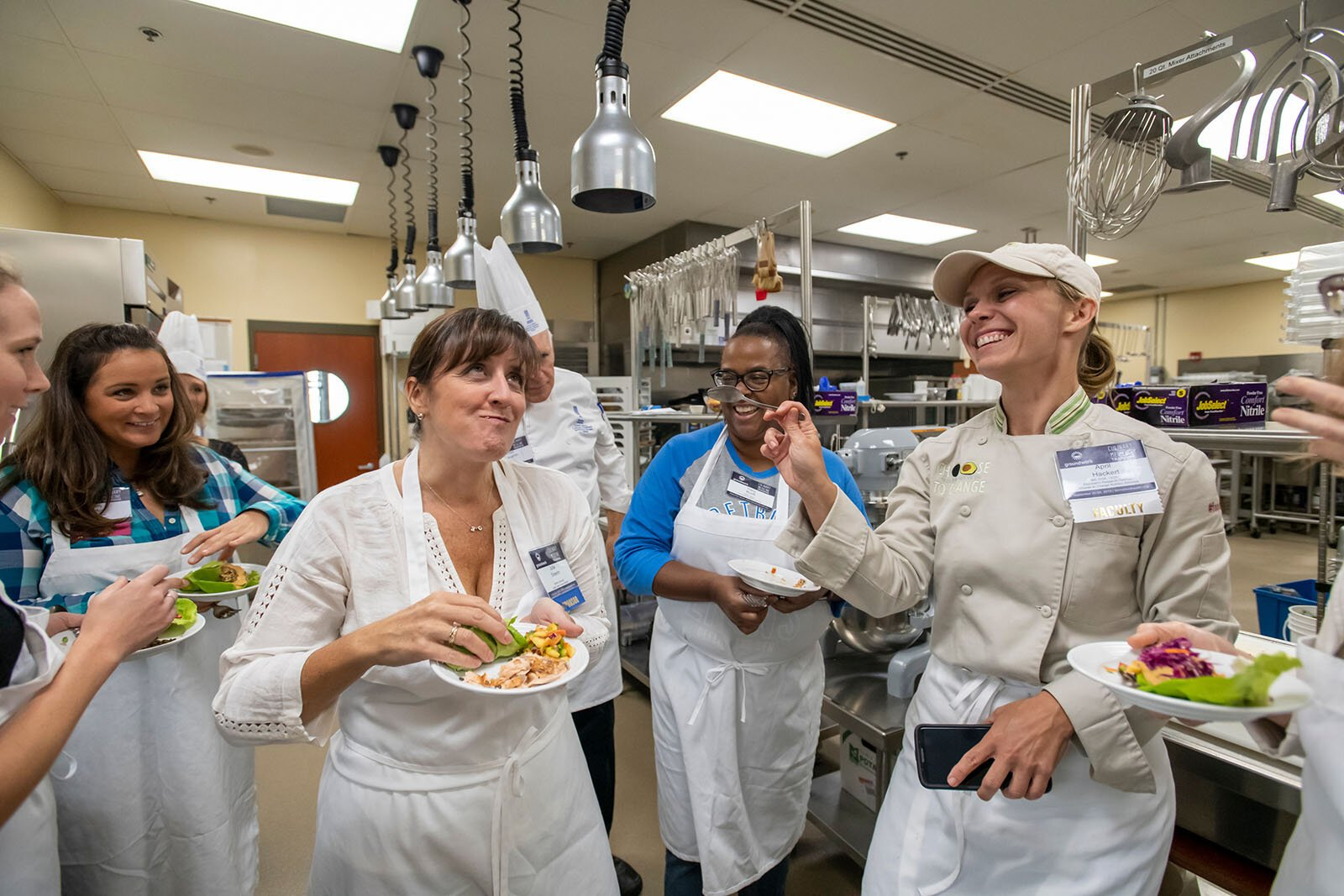 Mental health specialist, chef, and dietitian April Hackert (right in jacket) enjoys plant-forward recipes with participants at culinary medicine training offered by Groundwork Center.
