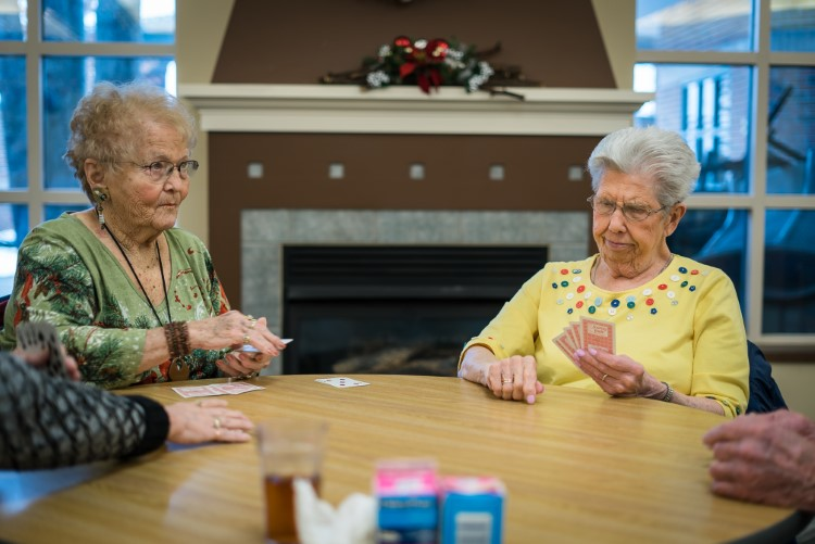 Seniors play poker at Sanford Activity and Dining Center in Midland.