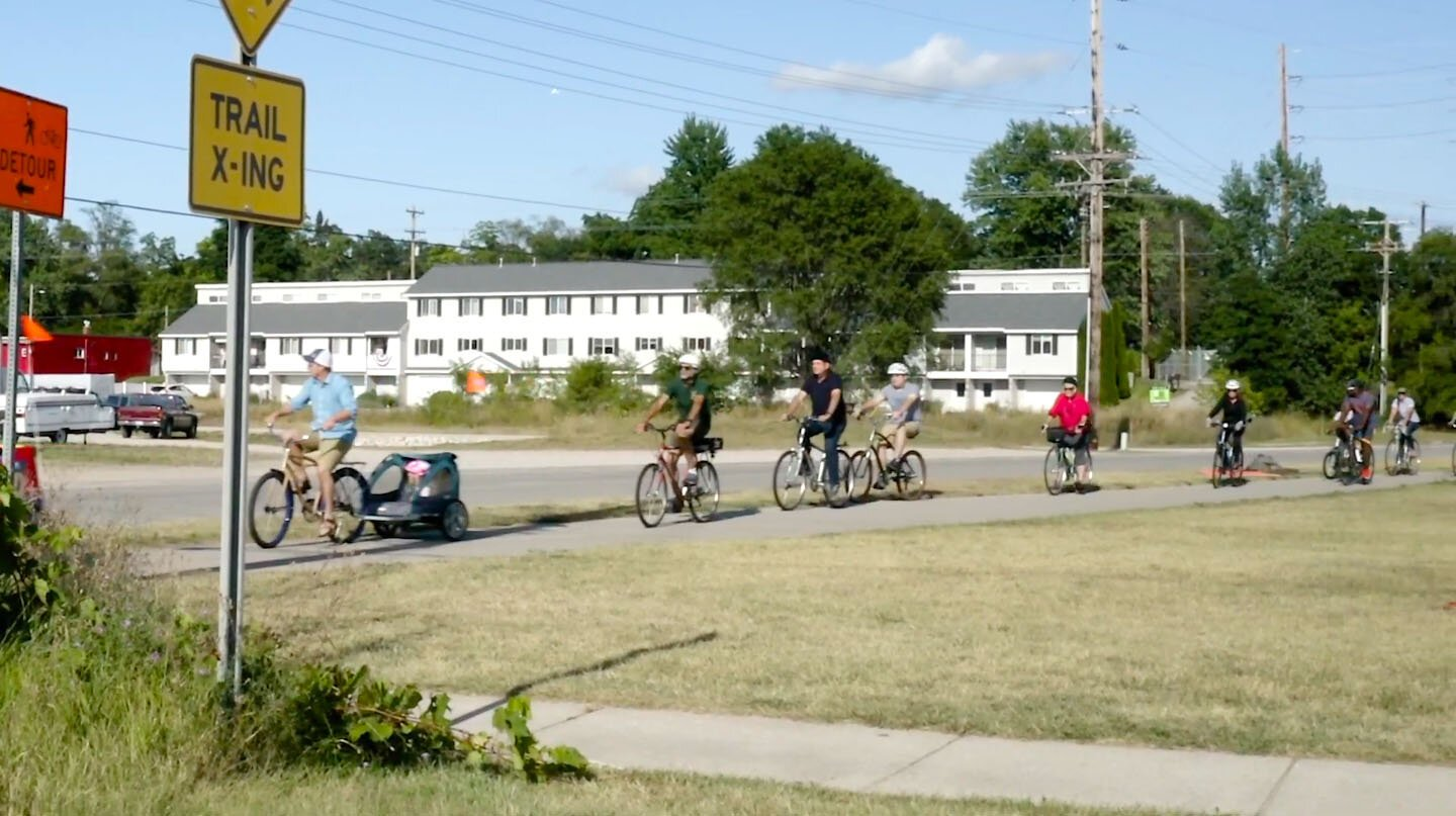 Families ride bikes in Traverse City.