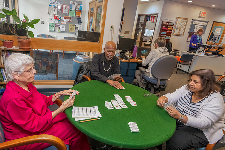 Clients play cards at Turner Senior Resource Center.