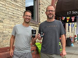 Andrew Boyd and Jeremy Miller outside the Grand Haven Armory.