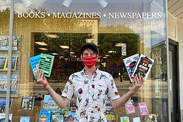 Steven Penkevich in front of Reader's World in downtown Holland.