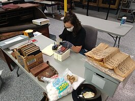 Margaret Paxton, Assistant to the Curator of Collections, works at the Community Archives and Research Center.