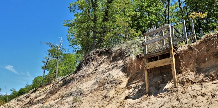 The stairway to the beach at Kirk Park falls victim to a shrinking dune.