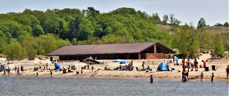 Pandemic restrictions limited Memorial Day attendance at Holland State Park.
