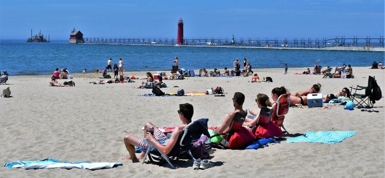 Memorial Day visitors to Grand Haven State Park practice safe social distancing.