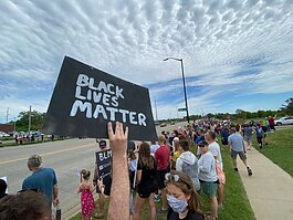 More than 3,000 people lined Unity Bridge on June 7 to show their solidarity in standing against racism in America.