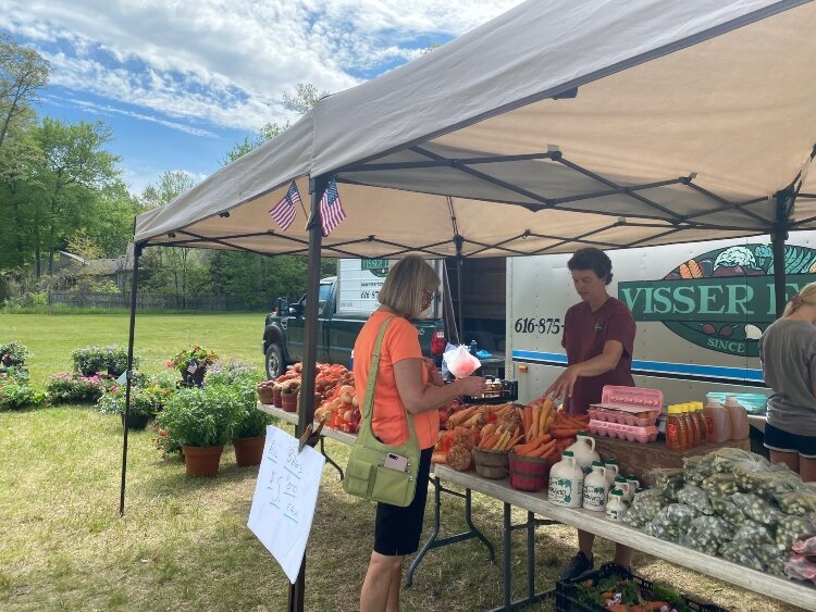 Visser Farms now operates a stand at Waukazoo Market on Holland's northside.