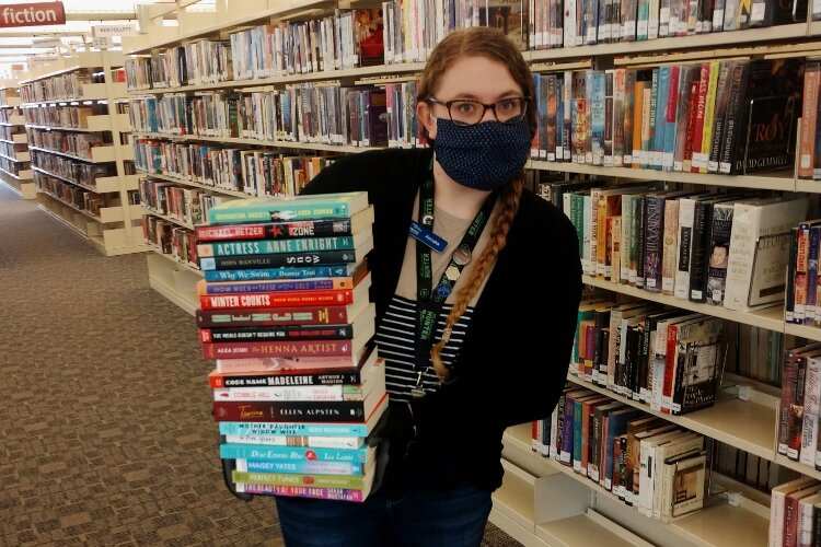 Librarian Annaka Koster will be among HDL staff who will curate take-and-make boxes for March is Reading Month.
