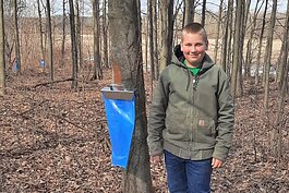 Colby Tucker, 14, from Hopkins in Allegan County, is in his third year of collecting and cooking sap.
