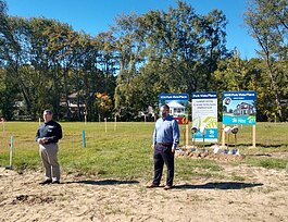 Jubilee Ministries Executive Director Steve Grose and Lakeshore Habitat for Humanity Executive Director Don Wilkinson speak to a crowd before a ceremonial groundbreaking at Park Vista Place on East 40th Street in Holland.