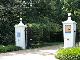 White pillars mark the entrance to the former Lakewood Farm, aka Getz Zoo, as they appear today. (Kym Reinstadler)