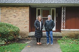 Michigan Fosters Executive Director Tiffany Kraker and Holland Heights CRC Parsonage Committee Chairman Kevin Anderson stand outside of what is soon to become Journey Home, a place for families navigating foster care.
