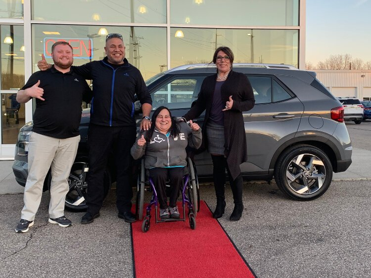 Lucia Rios is pictured with the team she worked from start to finish of buying her new car (from left: Jayden Engster, Junior de la Rosa, and Caryn de la Rosa)