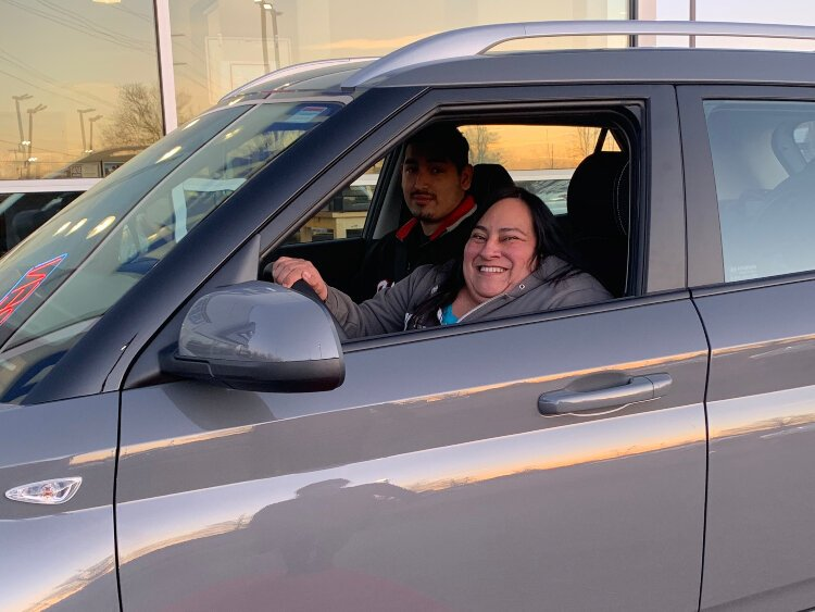 Lucia Rios's first time driving her new car. Her nephew Angelo Mata is in the front seat. He helped her identify how to work with the new technology.